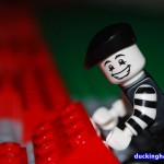 image of the Mime putting together a piece for the Mime Magazine LEGO Mosaic